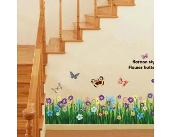 Frontière mur de papillon et de fleurs d'herbe